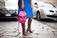 <p>Prada's classic black backpack (pictured here in a pink mini version) was so utilitarian with its buckles and waterproof material that it became an accessory staple for years.</p>