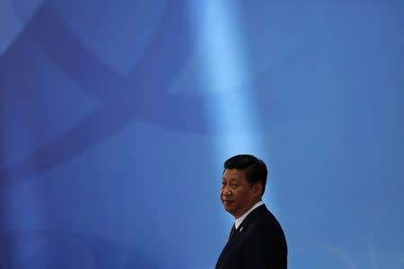 File photo of Chinese President Xi waiting for leaders to arrive before opening ceremony in Expo Center at fourth Conference on Interaction and Confidence Building Measures in Asia summit in Shanghai