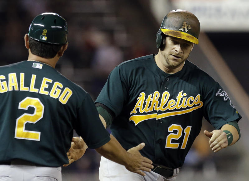 Reversed call helps A's score 10 in 4th inning