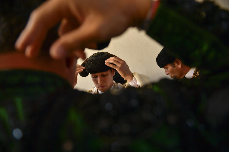 Spanish bullfighter Gines Marin adjusts his ''montera'' before entering the bullring at the San Fermin Festival in Pamplona, northern Spain, July 7, 2019. (Photo: Alvaro Barrientos/AP)