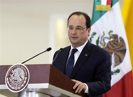 French President Francois Hollande addresses the audience at the National Aeronautic University of Queretaro in Queretaro