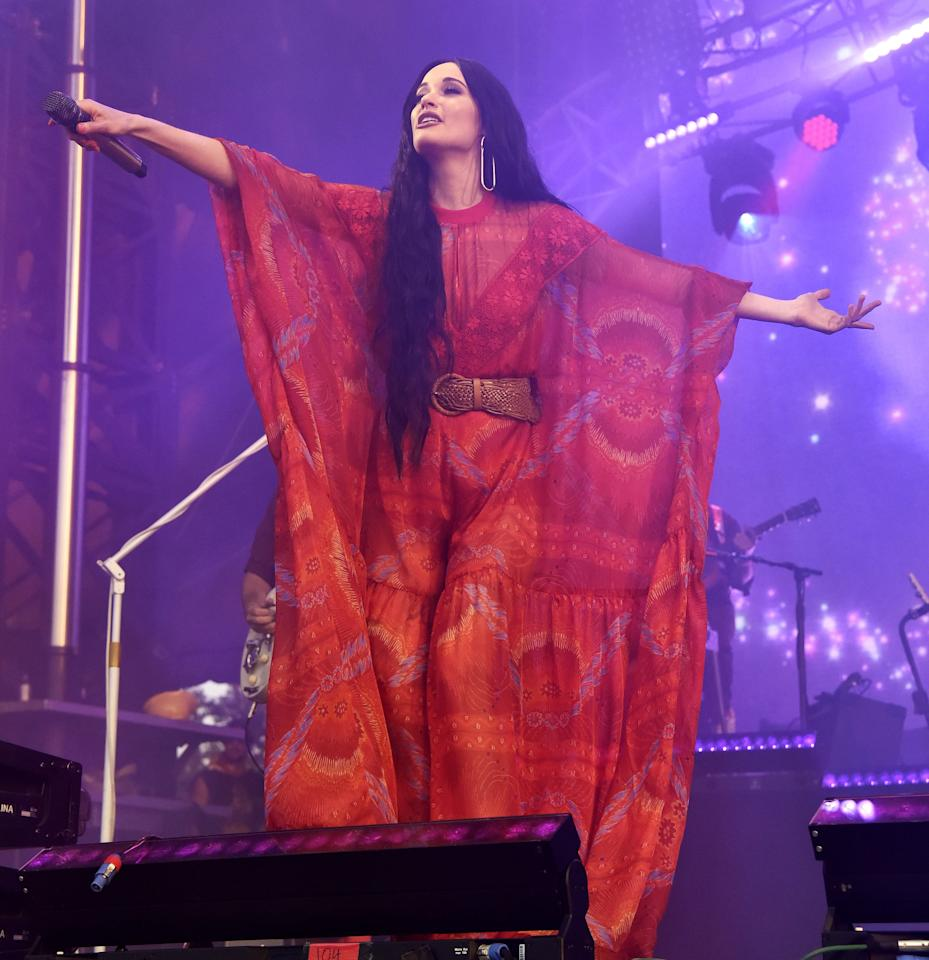 <p>Channeling her inner '70s queen, Kacey performed in this flowy Giamba jumpsuit with violet floral pattern details.</p>