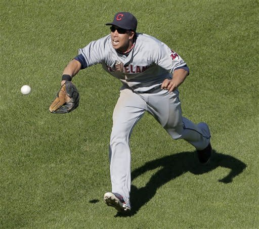 Cleveland Indians center fielder Michael Brantley catches a fly ball hit by Kansas City Royals' Billy Butler to end the sixth inning of a baseball game on Sunday, Sept. 23, 2012, in Kansas City, Mo. (AP Photo/Charlie Riedel)