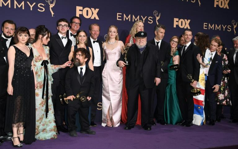 "The cast of ""Game of Thrones"" pose with author George R.R. Martin after winning the Emmy for best drama series (AFP Photo/Robyn Beck)"