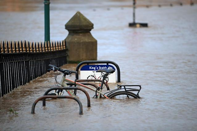 A cycle rack engulfed by floodwater after the River Ouse burst its banks in York. (PA)