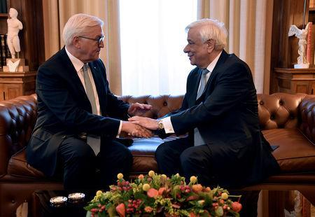 Greek President Prokopis Pavlopoulos (R) meets with German President Frank-Walter Steinmeier at the Presidential Palace in Athens, Greece, October 11, 2018. REUTERS/Michalis Karagiannis/Pool