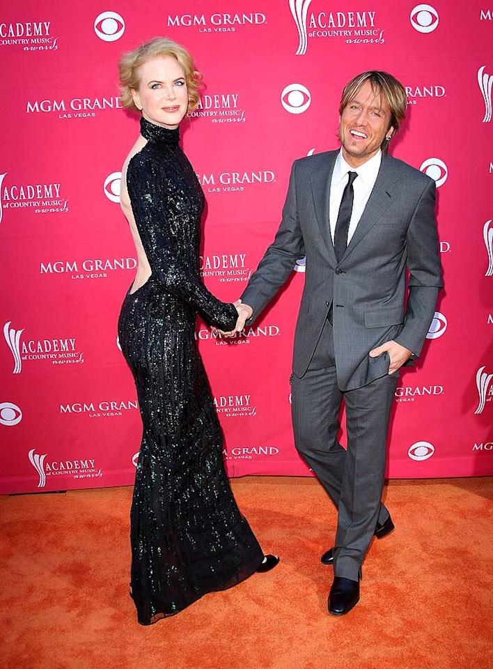 "A statuesque Nicole Kidman donned a backless L'Wren Scott gown. The only accessory needed? Her handsome husband, Keith Urban. Jason Merritt/<a href=""http://www.gettyimages.com/"" target=""new"">GettyImages.com</a> - April 5, 2009"