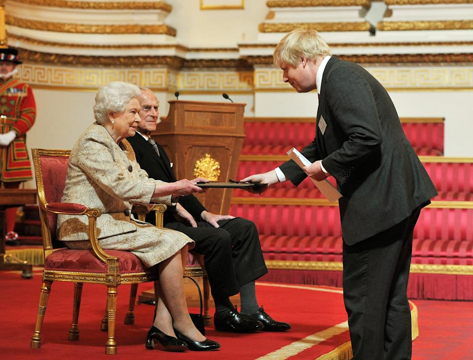 Queen Elizabeth II accompanied by the Duke of Edinburgh receives a copy of the loyal address from the Mayor of London Boris Johnson, during a presentation of loyal addresses by the privileged bodies, at a ceremony to mark the Her majesty's diamond Jubilee at Buckingham Palace in central London.   (Photo by John Stillwell/PA Images via Getty Images)