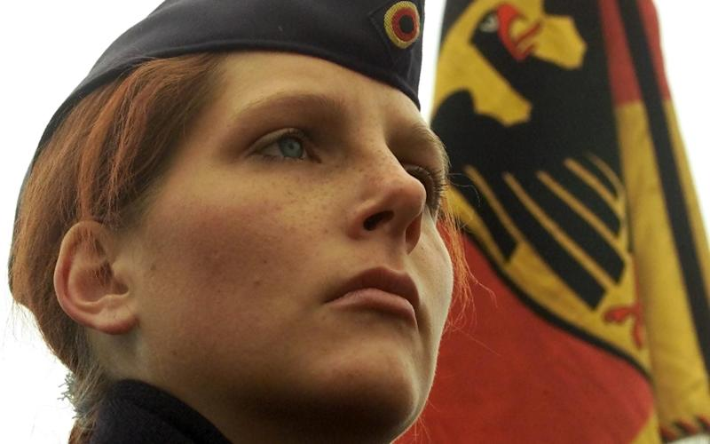 German female recruit Desiree Berghoff attends the first swearing in ceremony with female soldiers of the German air force together with comrades at the 2nd air force battalion barracks in Goslar, about 300 kilometres west of the German capital Berlin - FABRIZIO BENSCH/Reuters