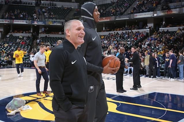 Referee Monty McCutchen and Myles Turner of the Pacers stand on the court before a game against the Nuggets on Dec. 10, 2017 at Bankers Life Fieldhouse in Indianapolis. (Photo by Ron Hoskins/NBAE via Getty Images)