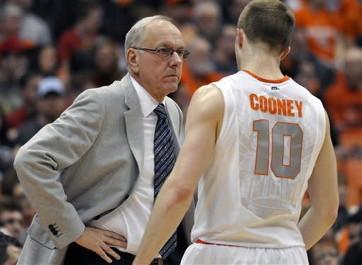 Syracuse head coach Jim Boeheim gives Tevor Cooney a stearn look during the second half against Alcorn State in an NCAA college basketball game in Syracuse, N.Y., Saturday, Dec. 29, 2012. Syracuse won 57-36. (AP Photo/Kevin Rivoli)