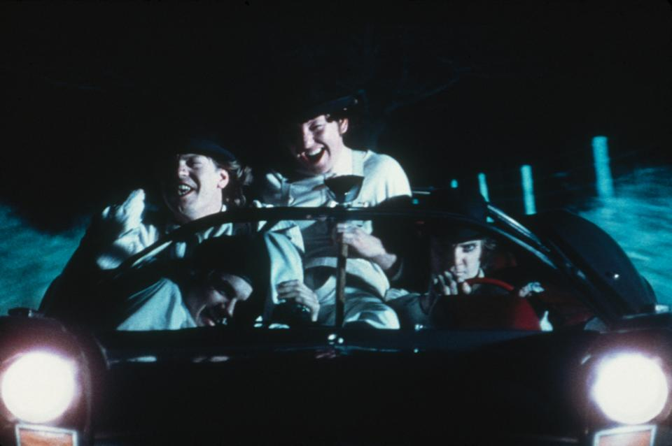 British actor Malcolm McDowell goes joyriding with his droogs in a scene from 'A Clockwork Orange', 1971. (Photo by Warner Bros./Fotos International/Getty Images)