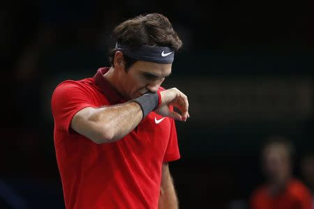 Switzerland's Roger Federer reacts during his men's singles quarter-final tennis match against Milos Raonic of Canada at the Paris Masters tennis tournament at the Bercy sports hall in Paris, October 31, 2014. REUTERS/Benoit Tessier