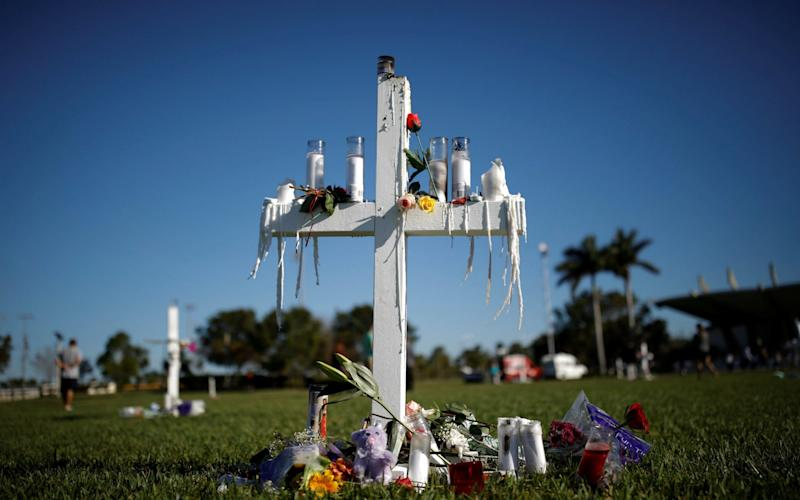 Crosses are seen in a park to commemorate the victims of the shooting at Marjory Stoneman Douglas High School, in Parkland - REUTERS
