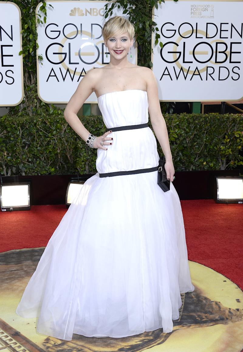Lawrence arrived to the 71st Annual Golden Globe Awards in Los Angeles, California, rocking her stylish new pixie cut and wearing a stunning strapless white-and-black Dior confection.