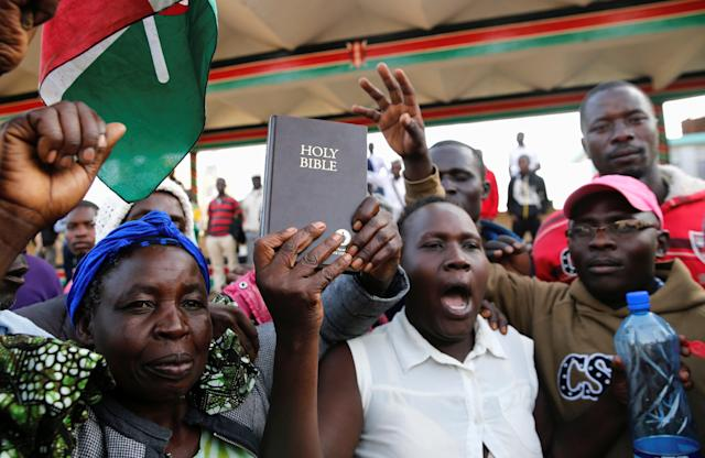 <p>Supporters of Kenyan opposition leader Raila Odinga of the National Super Alliance (NASA) coalition hold a Bible ahead of his planned swearing-in ceremony as the president of the peopleís assembly in Nairobi, Kenya, Jan. 30, 2018. (Photo: Thomas Mukoya/Reuters) </p>