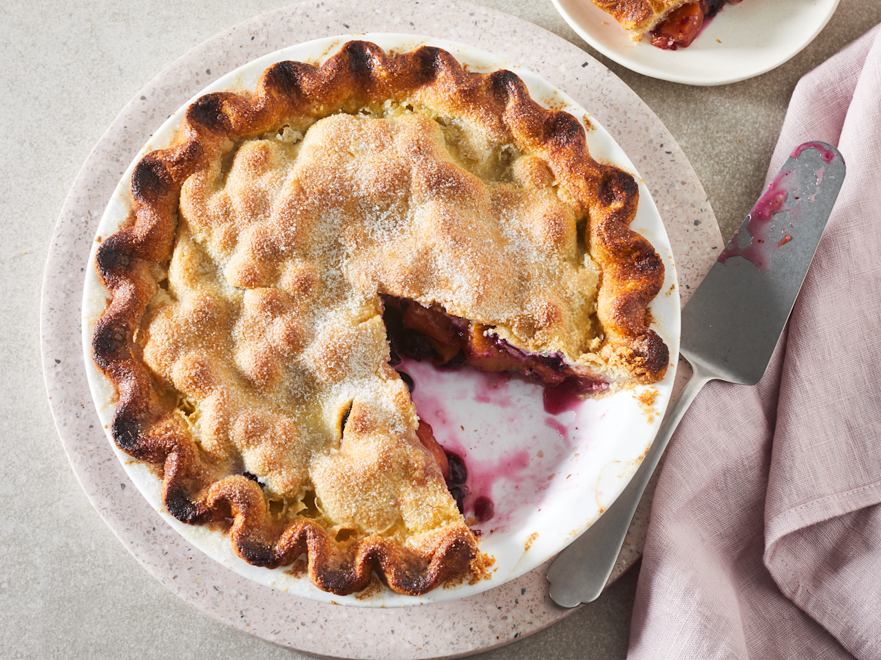 """<p>Two of summer's best crops unite to form a classic dessert you'll want to bring to every cookout. Our Peach Blueberry Pie is sweet and fruity with a flaky crust. Using parchment paper in the oven will help catch any drippage. Truthfully, fruit pies are something that should be made a day ahead, and the longer this cools, the lower your chances of an overly juicy pie. If you have a pizza stone, use that instead of a baking sheet to aid the cooling process. Serve for dessert with vanilla ice cream, or at breakfast with a scoop of yogurt and a coffee.</p> <p><a href=""""https://www.myrecipes.com/recipe/peach-blueberry-pie"""">Peach Blueberry Pie Recipe</a></p>"""