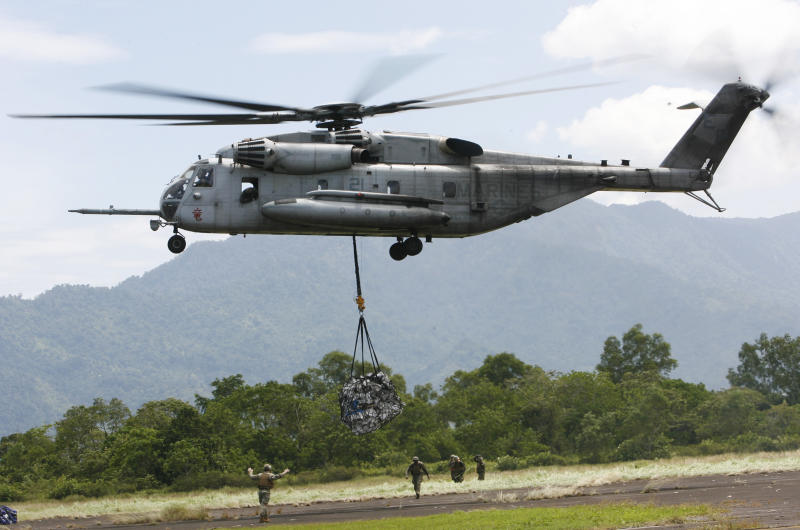 <p> FILE - In this Saturday Oct. 10, 2009, file photo, a U.S. military helicopter, the CH-53E Super Stallion, airlifts humanitarian aid to be dropped in affected regions around Pariaman, north of Padang, Indonesia. On Tuesday, April 3, 2018, a CH-53E Super Stallion similar to the one shown went down shortly after 2:30 p.m., during a training mission near El Centro, Calif., a few miles from the U.S.-Mexico border. (AP Photo/Wong Maye-E, File) </p>