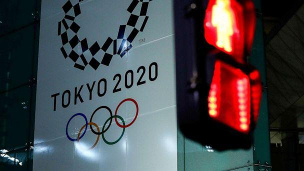 PHOTO: A banner for the upcoming Tokyo 2020 Olympics is seen through a traffic signal in Tokyo, March 11, 2020. (Issei Kato/Reuters, FILE)