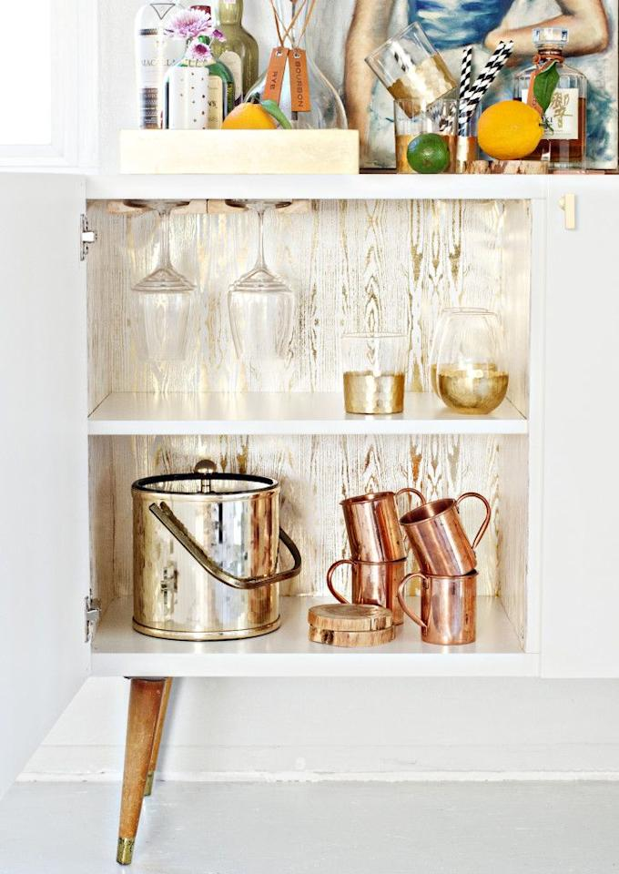 """<p>Here, two of  Ikea's BESTA cabinets (they're no longer in stock, but any kitchen cabinet will work) in white high gloss combine together along with wooden peg legs to create the ultimate bar cabinet even Don Draper would be proud to own.</p><p><em><a href=""""http://www.brittanymakes.com/2015/02/25/ikea-hack-mid-century-bar-cabinet/"""" target=""""_blank"""">Get the tutorial at Brittany Makes »</a></em><a href=""""http://www.brittanymakes.com/2015/02/25/ikea-hack-mid-century-bar-cabinet/"""" target=""""_blank""""></a></p>"""