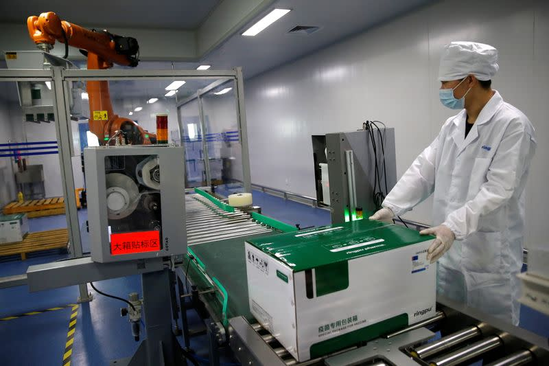 An employee works at a packaging line at Ringpu Biotech in Tianjin