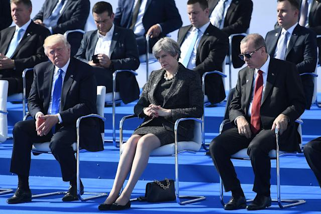 <p>(From L) US President Donald Trump, Britain's Prime Minister Theresa May and Turkish President Recep Tayyip Erdogan attend the NATO (North Atlantic Treaty Organization) summit ceremony at the NATO headquarters, in Brussels, on May 25, 2017. (Photo: Justin Tallis/AFP/Getty Images) </p>