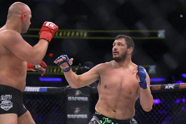 Matt Mitrione (R) moves in to battle Fedor Emelianenko Saturday at Madison Square Garden. (The Associated Press)