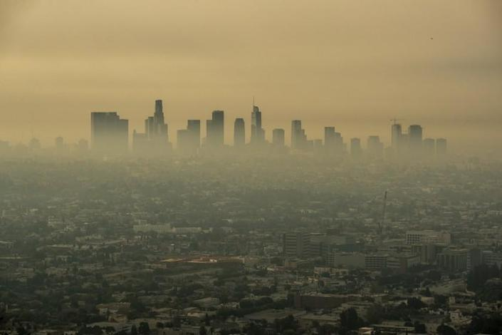 LOS ANGELES, CA - SEPTEMBER 17: Smoke from Southern California wildfires drifts through the L.A. Basin, obscuring downtown skyscrapers in a view from a closed Griffith Observatory on Thursday, Sept. 17, 2020 in Los Angeles, CA. (Brian van der Brug / Los Angeles Times)