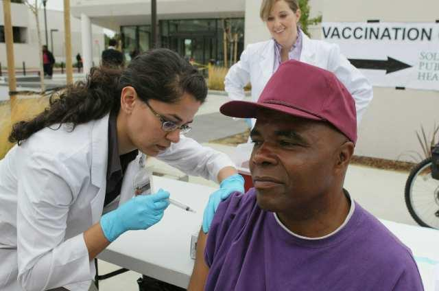 "A man gets a flu shot in pre-COVID times. <span class=""copyright"">(Justin Sullivan / Getty Images)</span>"