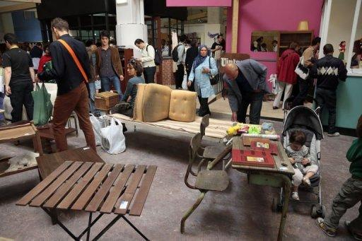People check second-hand furniture in Paris