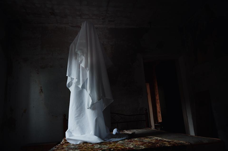 Ghost standing on the bed.