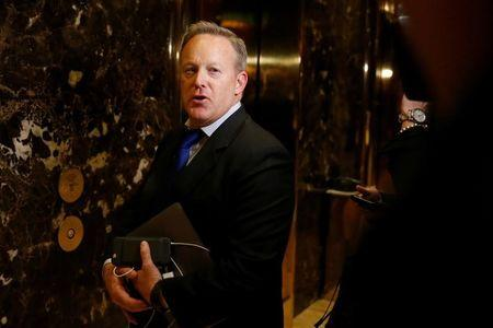 Chief Strategist & Communications Director for the Republican National Committee Sean Spicer arrives in the lobby of Republican president-elect Donald Trump's Trump Tower in New York