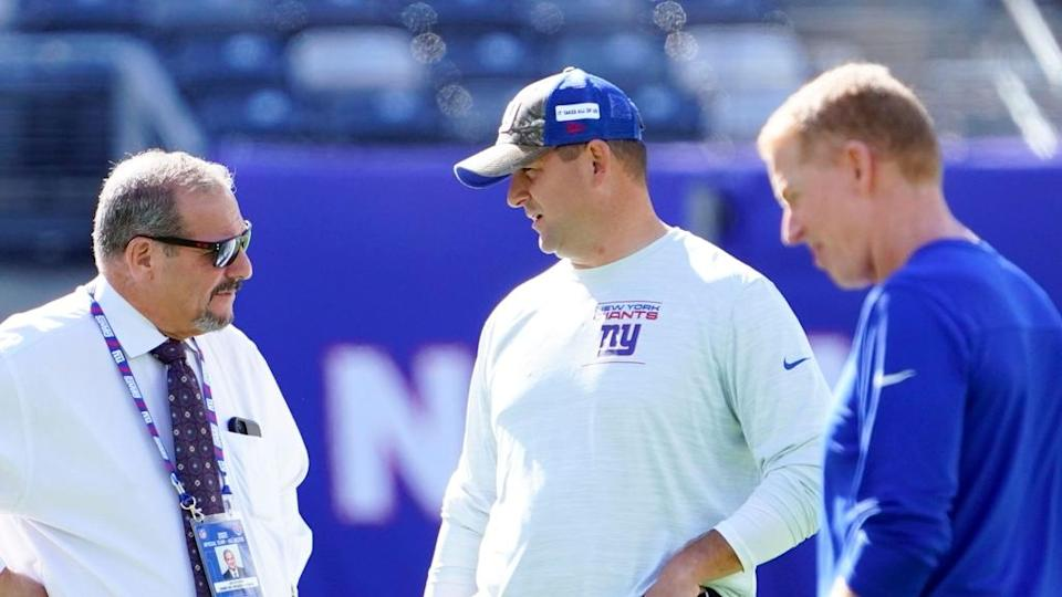 (from left) New York Giants general manager Dave Gettleman, head coach Joe Judge, and offensive coordinator Jason Garrett on the field before the game at MetLife Stadium on Sunday, Sept. 26, 2021, in East Rutherford.