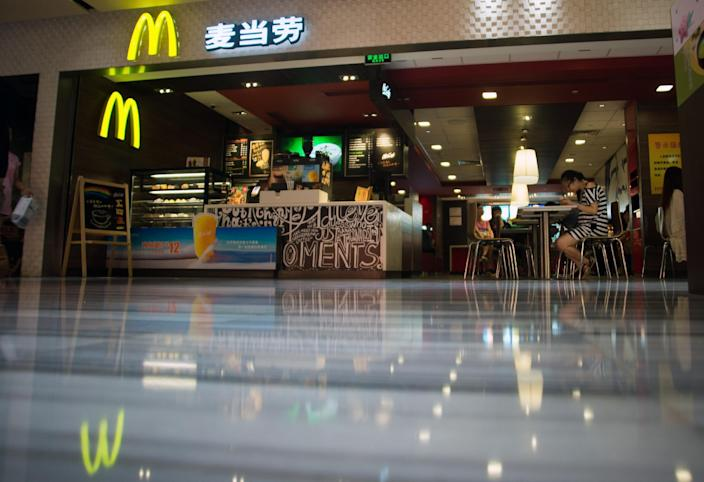 People eat at a McDonald's restaurant in Shanghai on July 22, 2014 (AFP Photo/Johannes Eisele)
