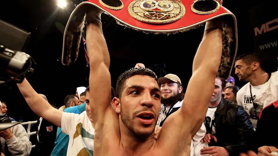 Pictured here, Billy Dib holds the IBF Featherweight belt aloft after beating Jorge Lacierva in 2011.