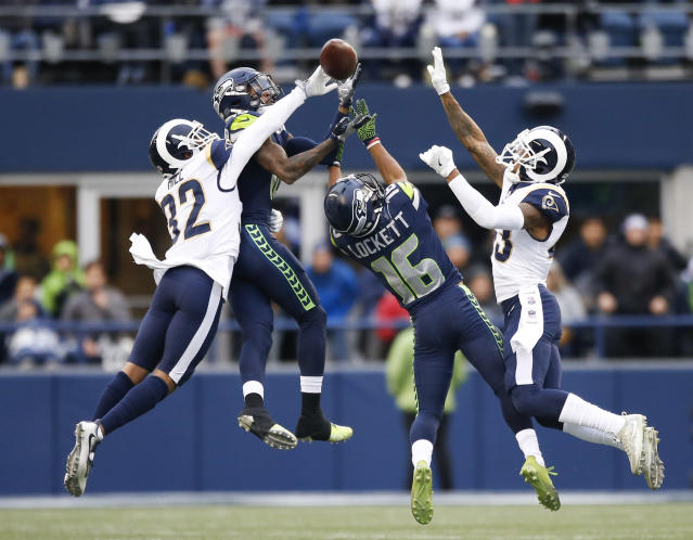 <p>Cornerback Troy Hill #32 of the Los Angeles Rams knocks away a pass as wide receiver Paul Richardson #10 of the Seattle Seahawks and Tyler Lockett #16 try to make the completion during the 2nd quarter of the game at CenturyLink Field on December 17, 2017 in Seattle, Washington. (Photo by Otto Greule Jr /Getty Images) </p>