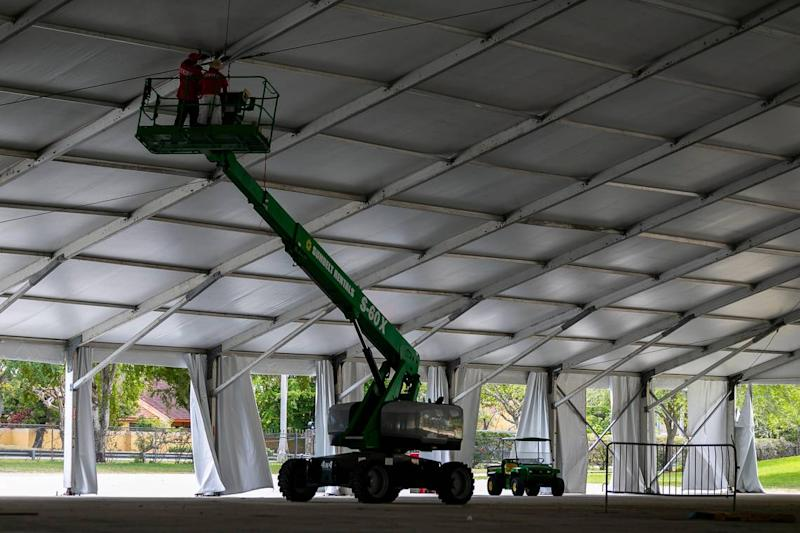 Construction crews assemble a 250-bed field hospital at Miami-DadeÕs fairgrounds in Westchester, Florida on Tuesday, March 24, 2020. The hospital is being built in preparation for a surge of coronavirus cases.
