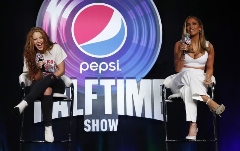 Colombian singer Shakira (L) and US singer Jennifer Lopez speak during the Super Bowl LIV Halftime Show press conference three days before Super Bowl LIV in Miami, Florida, USA, 30 January 2020. The San Francisco 49ers and the Kansas City Chiefs will play in Super Bowl LIV at the Hard Rock Stadium in Miami Gardens, Florida, USA on 02 February 2020. EFE/EPA/JOHN G. MABANGLO