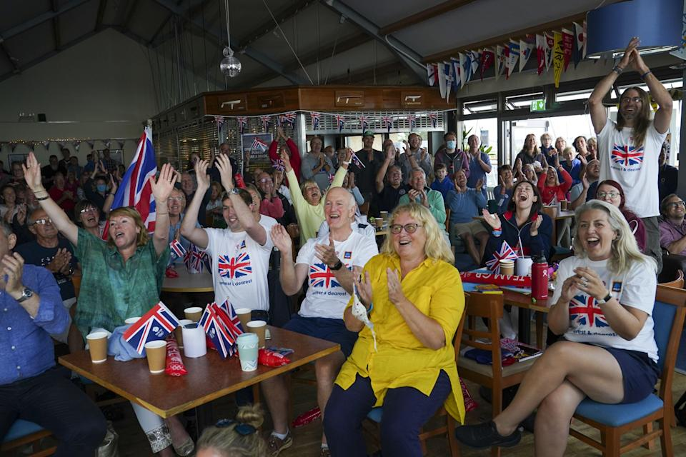 Family and friends of Olympic gold medallist Eilidh McIntyre celebrate at Hayling Island Sailing Club, Hampshire, as her boat crosses the finish line at Tokyo 2020 (Steve Parsons/PA) (PA Wire)
