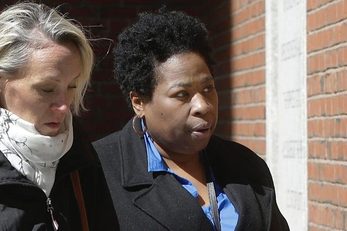 In this March 25, 2019, file photo, former college entrance exam administrator Niki Williams of Houston, right, arrives at federal court in Boston to face charges in a nationwide college admissions bribery scandal.