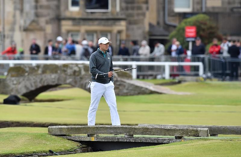US golfer Jordan Spieth walks over the bridge to the 1st green during his first round on the opening day of the British Open on The Old Course at St Andrews, on July 16, 2015