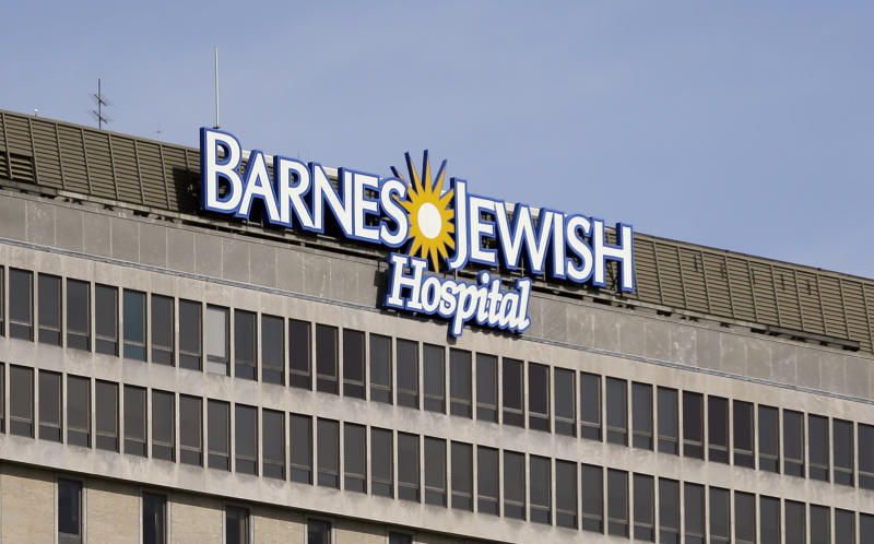 The sign for the Barnes-Jewish Hospital is seen in St. Louis, Monday, March 4, 2013. Your bosses want you to eat your broccoli, hit the treadmill and pledge you'll never puff on a cigarette. But a new study raises doubts that workplace wellness programs save the company money. In what's being called the most rigorous look yet inside the wellness trend, independent researchers tracked the program at a major St. Louis hospital system for two years. Employee hospitalizations dropped dramatically, by 41 percent overall for six targeted conditions. But increased outpatient costs erased those savings. (AP Photo/Jeff Roberson)