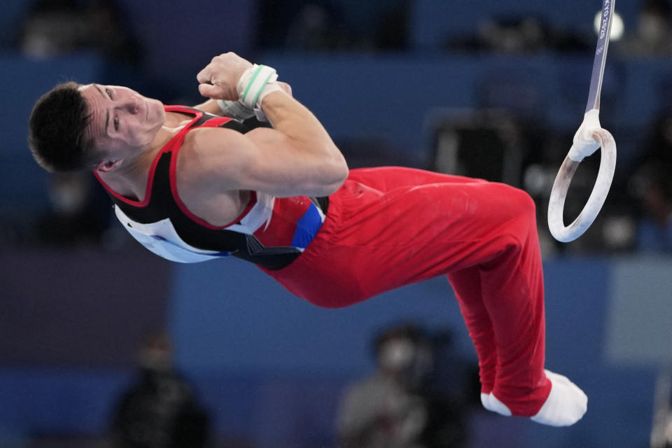 The Russian Olympic Committee's Nikita Nagornyy performs on the rings during men's artistic gymnastic qualifications at the 2020 Summer Olympics, Saturday, July 24, 2021, in Tokyo. (AP Photo/Natacha Pisarenko)