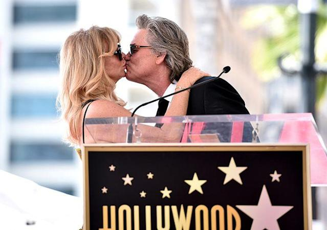 Goldie Hawn and Kurt Russell share a smooch while being honored with a double star ceremony on the Hollywood Walk of Fame. (Photo: Alberto E. Rodriguez/Getty Images)