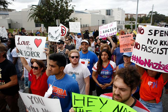 <p>Demonstrators gather at the site of a planned speech by white nationalist Richard Spencer, who popularized the term 'alt-right', at the University of Florida campus Oct.19, 2017 in Gainesville, Fla. (Photo: Brian Blanco/Getty Images) </p>