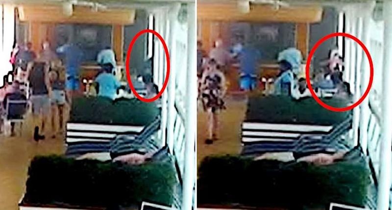 CCTV on board a Royal Caribbean cruise allegedly shows Salvatore Anello looking out a window before picking up his granddaughter Chloe Wiegand.