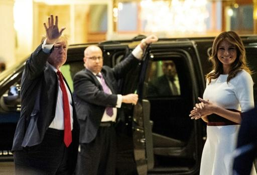US President Donald Trump and First Lady Melania Trump arrive for a Super Bowl viewing party at the Trump International Golf Club in West Palm Beach, Florida, the day before final arguments in his impeachment trial