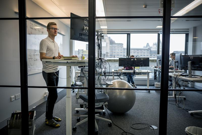 Employees of Smarkets work at their office in central London on March 12, 2018. Against a backdrop in Britain of gender pay gaps and ongoing disputes over executives' earnings, employees at one London company are helping each other set salaries. Betting firm Smarkets has adopted a radical pay transparency policy, through which staff can see colleagues' salaries and have pay rise requests endorsed by peers. / AFP PHOTO / TOLGA AKMEN / TO GO WITH AFP STORY by Rosie SCAMMELL (Photo credit should read TOLGA AKMEN/AFP via Getty Images)