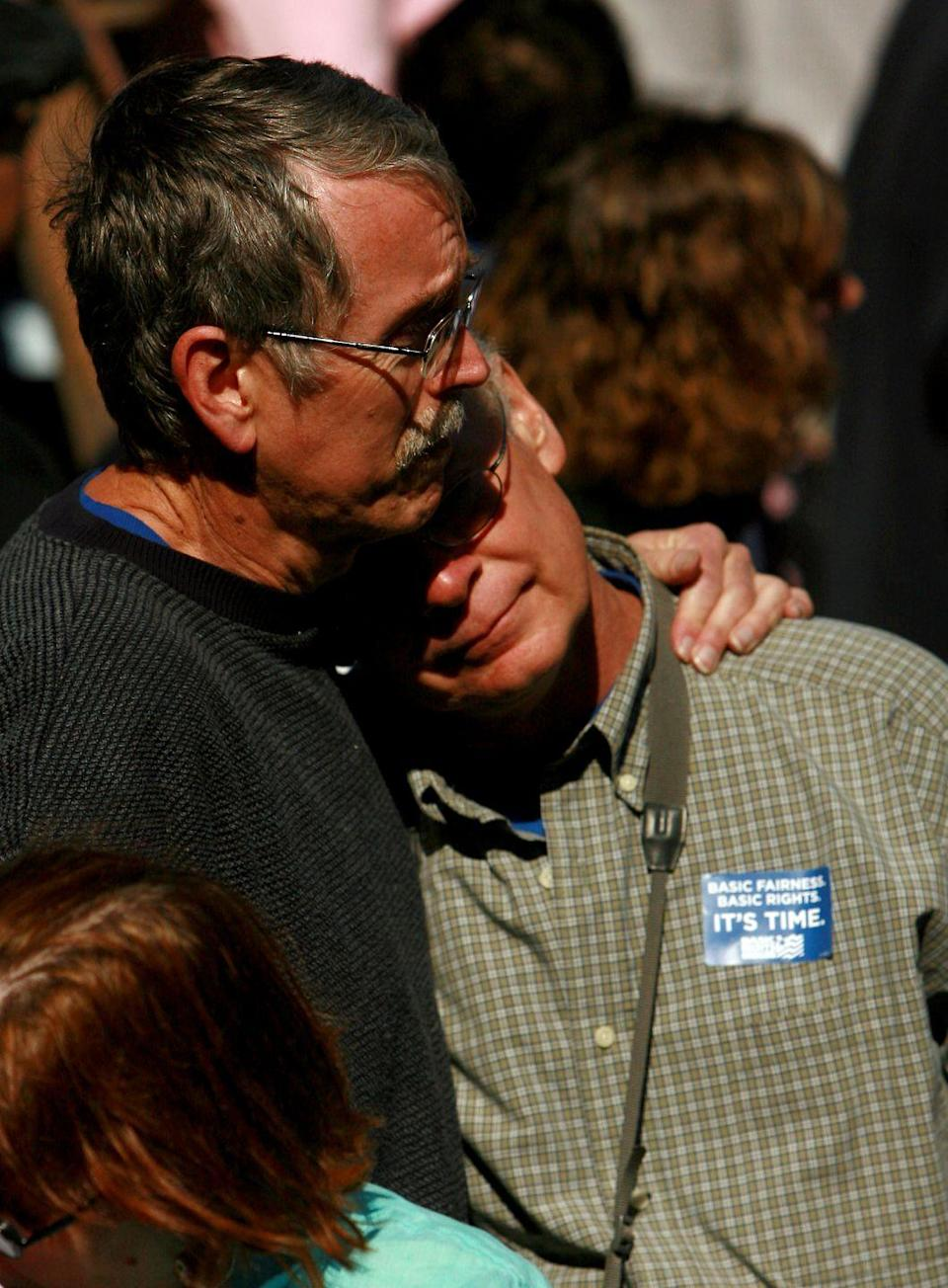 <p>Partnered for 30 years, Ron and Ken (pictured here) have an emotional moment after the Oregon Family Fairness Act and the Oregon Equality Act was passed in 2007. The bills allowed committed same-sex relationships as domestic partnerships and discrimination protections for LGBTQ+ members in employment, housing and other public sectors. <br></p>