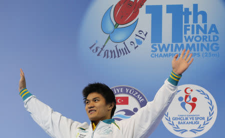 Silver medallist Kenneth To of Australia waves during the award ceremony for the men's 100m individual medley final during the FINA World Swimming Championships in Istanbul December 16, 2012.                REUTERS/Murad Sezer